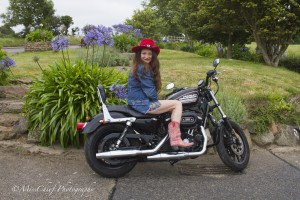 Dina sitting on a Harley Davidson